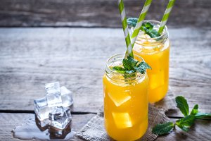 Glass jars of mango juice