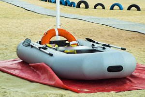 Inflatable Rescue Boat. Gray inflatable boat on the beach in the sand