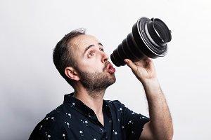 Man using camera lens as megaphone