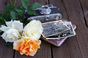 Old camera, family photos and roses