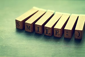 Wooden letters with SMILE phrase