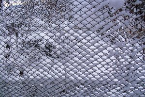 Iron chain fence in snow