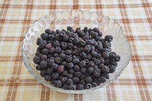 Plate with berries black blackberries