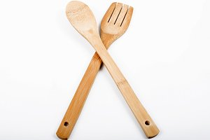 Wooden spoon and fork on white background. Isolated.
