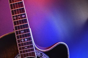 Acoustic guitar with red blue light