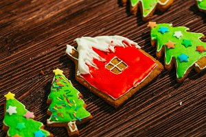 painted gingerbread house, Christmas tree on a wooden background