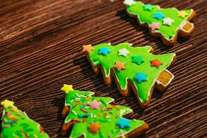 painted gingerbread Christmas tree on a wooden background