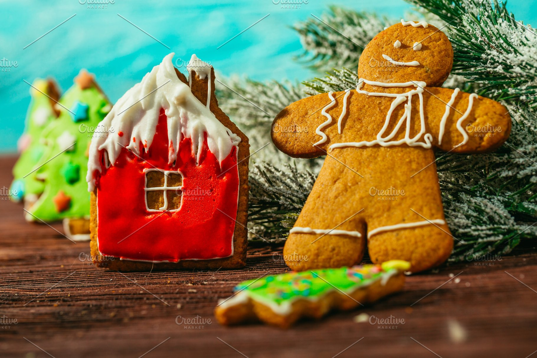 Christmas Gingerbread House Background.Painted Gingerbread House Christmas Tree And The Man On A Blue Background