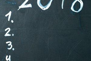 inscription 2018 do it list drawn with chalk on a school blackboard dark