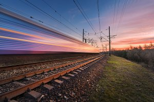 High speed train in motion at sunset