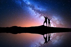 Milky Way with silhouette of couple
