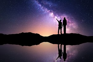 Milky Way with silhouette of men