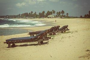 Wooden sunbeds on beach