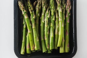 Fresh green asparagus. Farmer's Market. White background. Top view