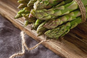 Fresh green asparagus. Farmer's Market. Gray background.