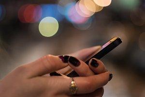Smart phone in female hands
