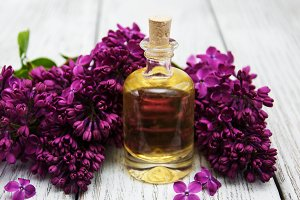 Aroma oil with lilac flowers
