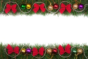 Christmas frame made of fir branches decorated with balls beads and red bows isolated on white background