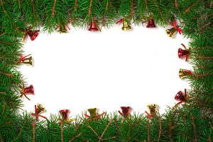Christmas frame made of fir branches decorated with red bells isolated on white background