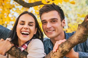Portrait of smiling young couple outdoors in autumn
