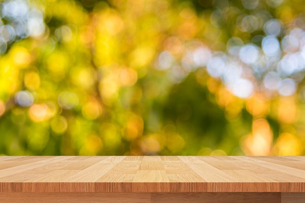 wood shelf on green leaves
