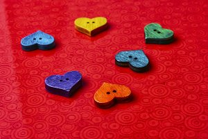 Symbolic hearts on red background