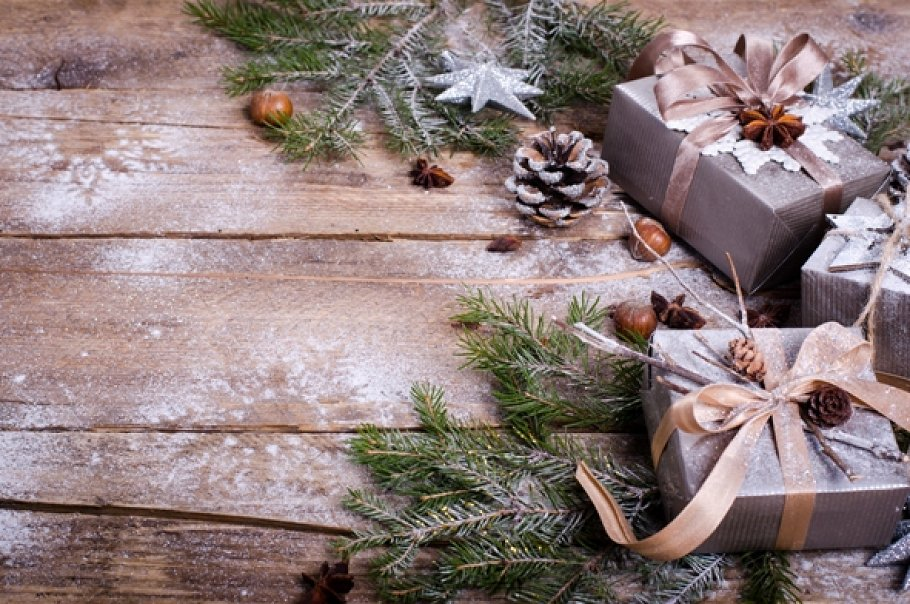 Rustic Christmas Wreath With Gifts On Wooden Background