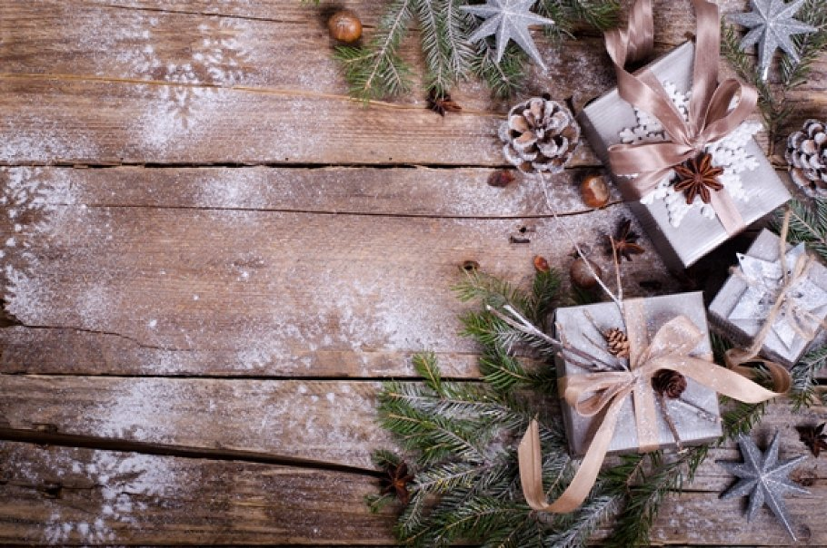 Rustic Christmas wreath with gifts on wooden background. Free space ...