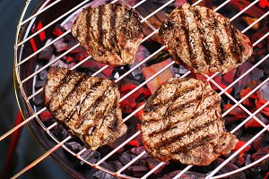 Pieces of sirloin are grilling