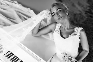 Bride behind a white piano