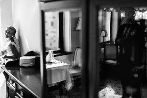 Bride sits behind a dresser