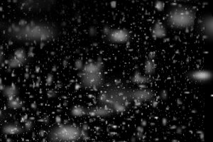 Falling snowflakes in the night sky