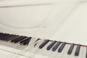 Veil lies on white piano keys