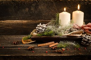Christmas decoration with candles, christmas ball, ribbon, fir cone, tree, anice star, cinamon. Candlelight. Wooden Background For Copy Space. Vintage Style