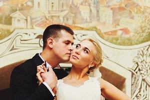 Groom kiss bride's cheek