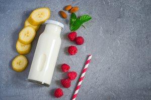 Ingredients for milkshake with juicy ripe raspberries and almond
