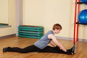 Man sits on a longitudinal splits
