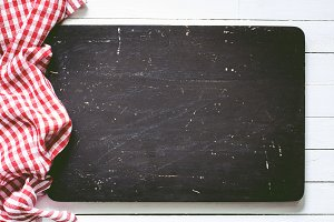 Black board and checkered textile