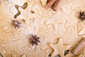 Christmas cooking with baking ingredients, anise stars, cinnamon