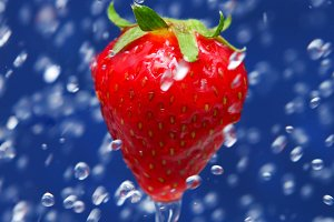 trawberry under drops of water