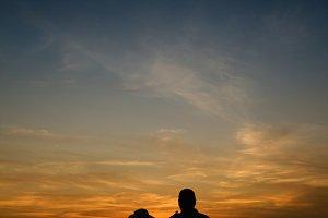 woman and man staying near sea