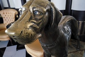 bronze statue of a  dog