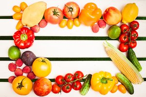 Juicy fruits and vegetables at white