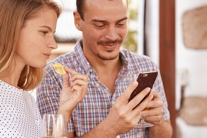 Couple having fun with technology