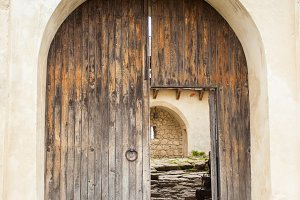 An old opened wooden door