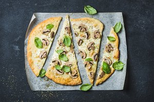 Homemade pizza with basil