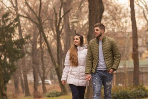young couple walking winter autumn