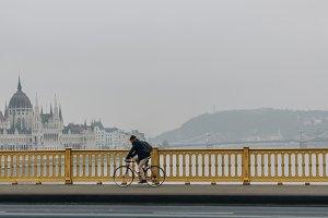 Man cycling on a bridge