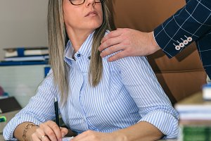 Boss sexual harassing to blonde secretary at workplace