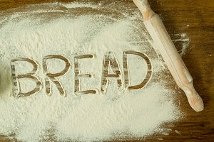 The word BREAD on the flour